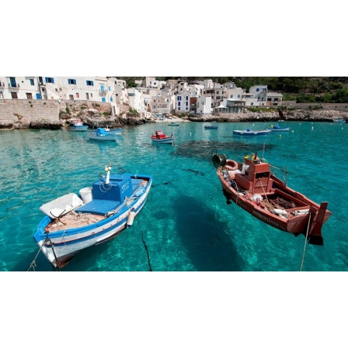 Boats floating on crystal clear waters in the Mediterranean